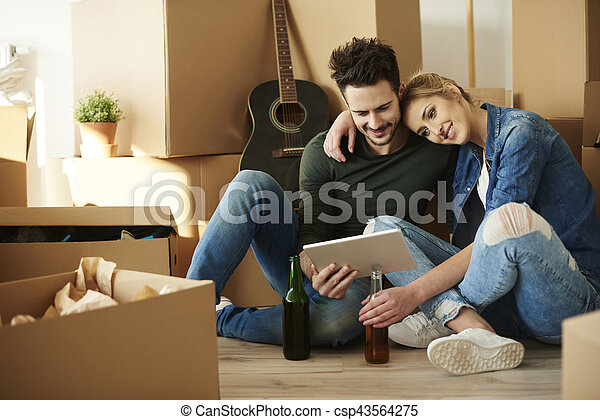 Young couple taking break from moving home - csp43564275