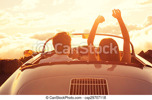 Young Couple Wathcing the Sunset in Vintage Sports Car - csp29707118