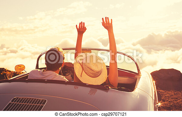 Young Couple Wathcing the Sunset in Vintage Sports Car - csp29707121