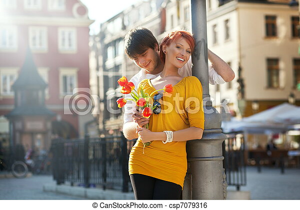 Young couple with flowers, outdoors - csp7079316