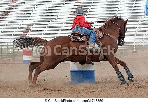 Young cowboy in a barrel Race - csp31748859