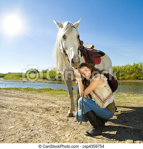 young cowgirl with white horse outdoor - csp4359754