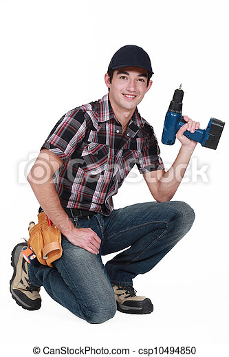 young craftsman holding a drill - csp10494850
