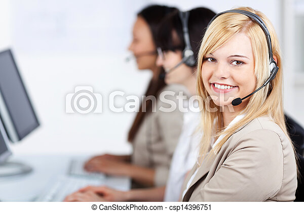 Young Customer Service Executive Wearing Headset In Office - csp14396751
