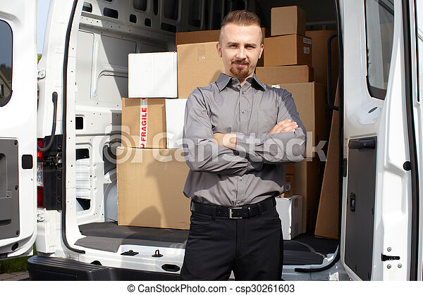 Young delivery man near truck. - csp30261603