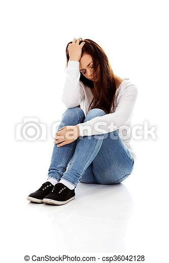 Young depression woman sitting on the floor - csp36042128