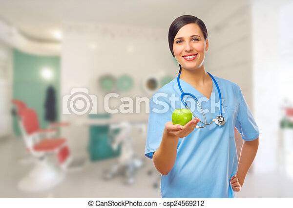 Young doctor with green apple - csp24569212