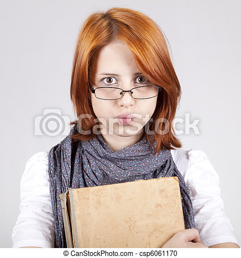 Young doubting fashion girl in glasses with old book - csp6061170