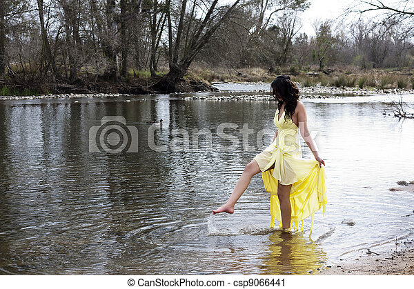 Young East Indian Woman Standing In River - csp9066441