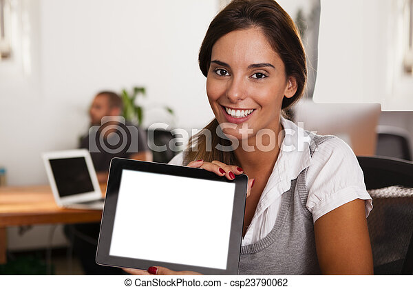 Young entrepreneur displaying her tablet computer - csp23790062