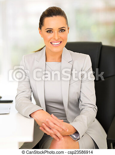 young entrepreneur sitting in office - csp23586914