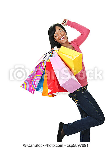 Young excited black woman with shopping bags - csp5897891