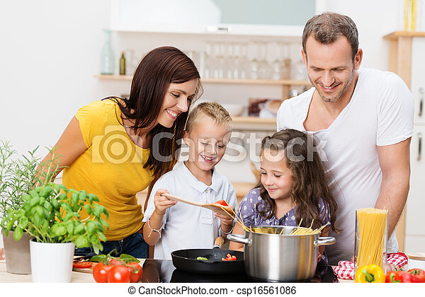 Young family cooking in the kitchen - csp16561086