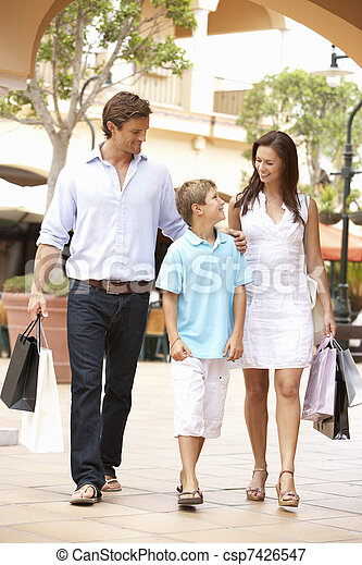 Young Family Enjoying Shopping Trip Together - csp7426547