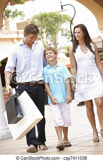 Young Family Enjoying Shopping Trip Together - csp7411038