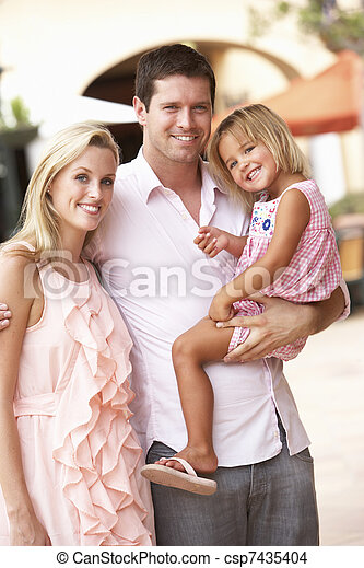 Young Family Enjoying Shopping Trip Together - csp7435404