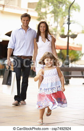 Young Family Enjoying Shopping Trip Together - csp7492924