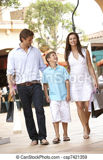 Young Family Enjoying Shopping Trip Together - csp7421359