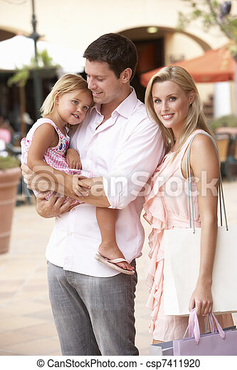 Young Family Enjoying Shopping Trip Together - csp7411920