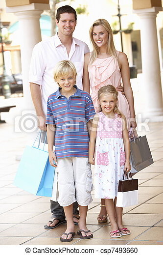Young Family Enjoying Shopping Trip Together - csp7493660