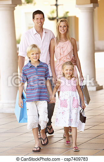Young Family Enjoying Shopping Trip Together - csp7409783