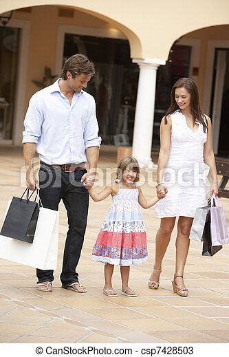 Young Family Enjoying Shopping Trip Together - csp7428503