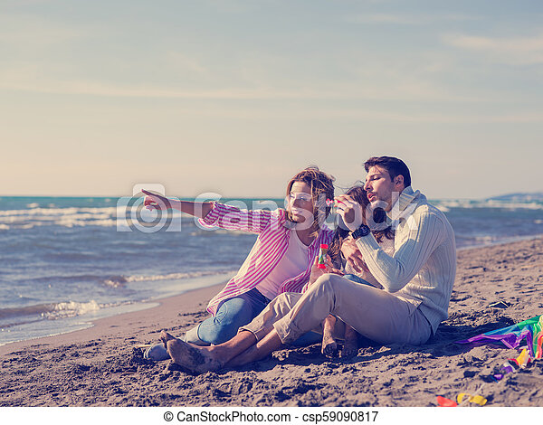 Young family enjoying vecation during autumn day - csp59090817