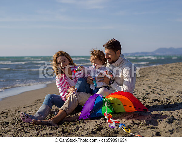 Young family enjoying vecation during autumn day - csp59091634