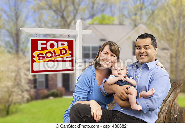 Young Family in Front of Sold Real Estate Sign and House - csp14806821