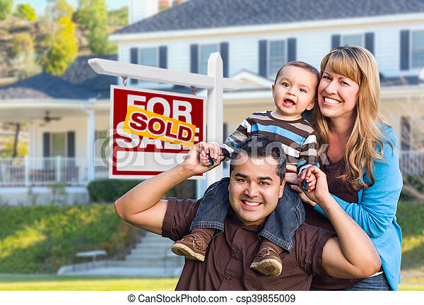 Young Family in Front of Sold Real Estate Sign and House - csp39855009