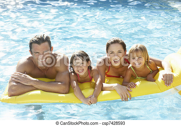 Young family, parents with children, in pool - csp7428593
