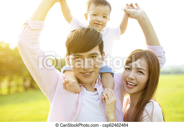 Young family with baby having fun in nature - csp62462484