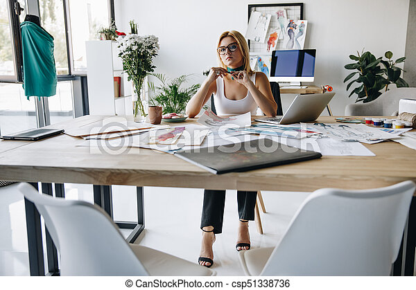 young fashion designer at workplace - csp51338736