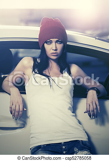 Young fashion woman standing next to her car - csp52785058