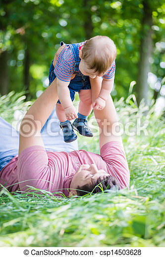 young father playing with his son - csp14503628