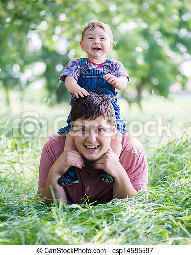 young father playing with his son - csp14585597