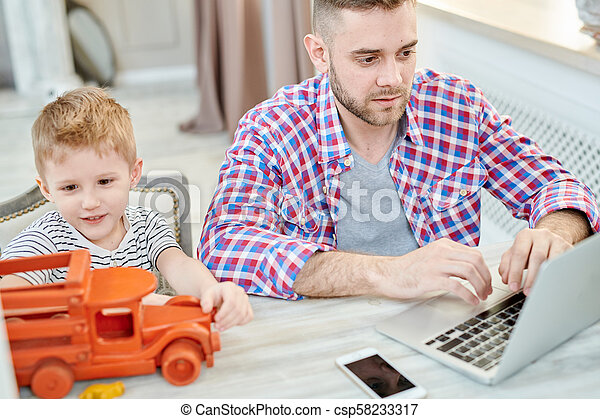 Young Father Working from Home - csp58233317