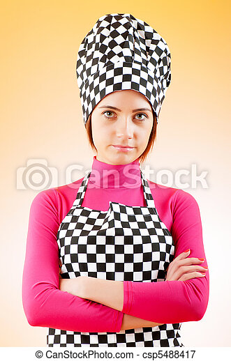 Young female cook against gradient background - csp5488417