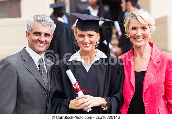 young female graduate with parents - csp18820146