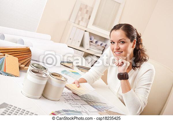 Young female interior designer at office - csp18235425