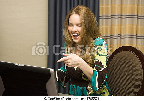 Young Female on Laptop Computer Laughing - csp1765571