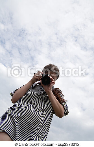 Young female photographer - csp3378012