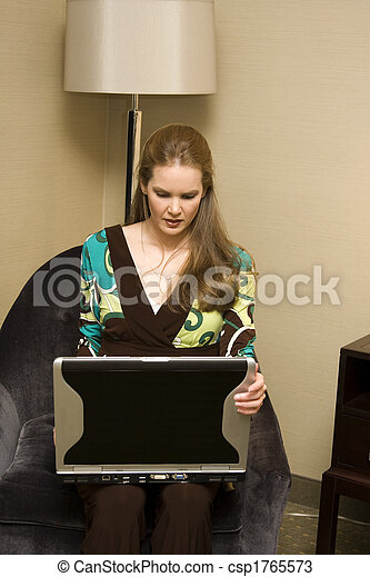 Young Female Sitting with Laptop Computer - csp1765573