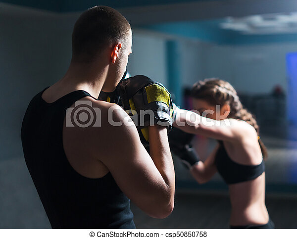 Young fighter boxer girl in training