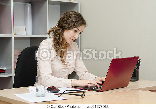 Young girl at a laptop in the office - csp21273083