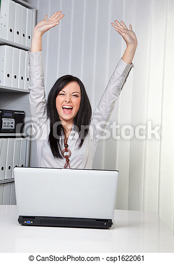 Young girl cheering on a computer - csp1622061