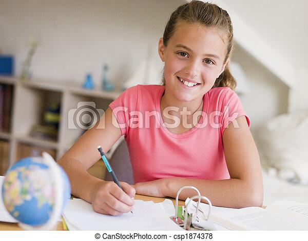 Young Girl Doing Her Homework - csp1874378