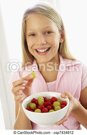 Young Girl Eating Fresh Fruit Salad - csp7434812