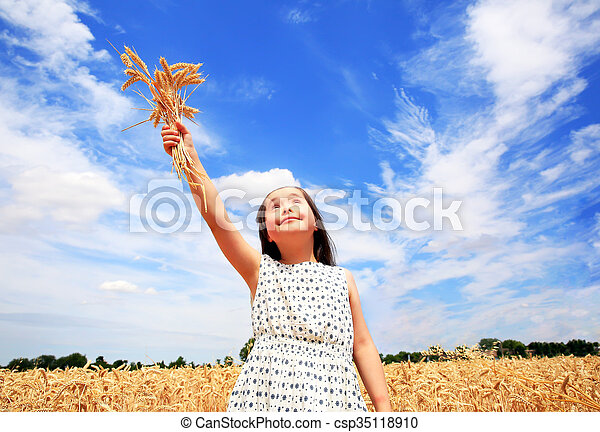 Young girl have fun in the wheat field - csp35118910