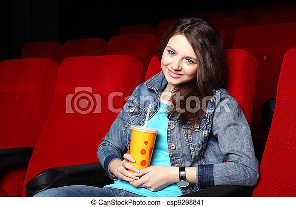 Young girl in cinema watching movie - csp9298841